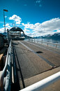 Ferry on norwegian fiord boat with loading ramp in foreground norway Stock Photo