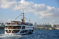 A ferry sails into the Bosphorus Sea, Istanbul. Royalty Free Stock Photo