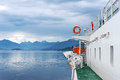 Ferry ship sailing in still water of a fjord Royalty Free Stock Photo
