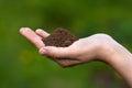 Fertile soil in hands of women Royalty Free Stock Photo