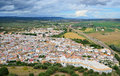 Fertile valley of the spanish river guadalquivir is photographed from above in spring there are small town almodovar del rio in Royalty Free Stock Photo
