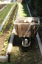Fertilization of a very tidy garden handmade wooden wheelbarrow containing only organic fertilizer to nourish and enrich the soil Stock Images