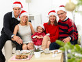 Festice family sitting at home at christmas time Stock Photography