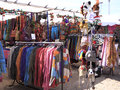 Festival clothes stall outdoor market selling colorful hippie style Stock Photo