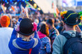 Festival goers enjoy a band at glastonbury festival the pyramid stage the takes place every year in june and is one of Royalty Free Stock Photography