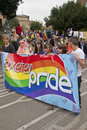 Festival goers hold up the Exeter Pride banner Stock Photos