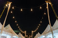 Festival lights decorated over market booths Royalty Free Stock Photography