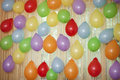 The festive atmosphere colorful balloons hanging on curtains in room Stock Photo