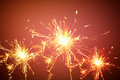 Festive background sparkler light on the red background Stock Photo