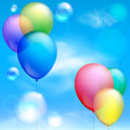 Festive balloons and bubbles against the blue sky clouds Royalty Free Stock Photo