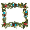 Festive border christmas of holly ivy mistletoe and blue bauble decorations over white background Stock Photography