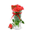 Festive bouquet of red roses in vase with ribbon rose lies next to vase Stock Images