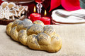 Festive bread on the table red christmas decorations in background Stock Photos