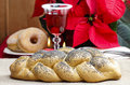 Festive bread on the table red christmas decorations in background Royalty Free Stock Photo