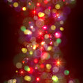 Festive christmas background with lights flickering multi colored on dark Stock Photos