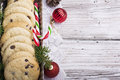 Festive Christmas card. Homemade cookies with chocolate drops for Santa Claus in the baking dish is decorated fir