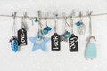 Festive christmas card in light blue and white colors with text. Royalty Free Stock Photo