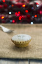 Festive christmas mince pie with bokeh lights in the background Royalty Free Stock Photography