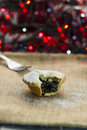 Festive christmas mince pie with bokeh lights in the background Stock Photography