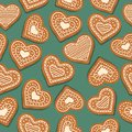 Festive Christmas seamless pattern with gingerbread hearts