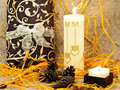 Festive composition with gift, candle and cones Royalty Free Stock Images