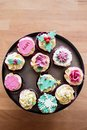 Festive cupcakes decorated with colored fondant on a stand Stock Image