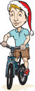 Festive cyclist a male riding a bike wearing a santa hat Royalty Free Stock Images