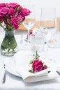 Festive dining table setting with pink roses Royalty Free Stock Image