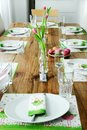 Festive dinner table set for easter brunch decorated in green an Royalty Free Stock Photo