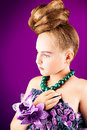 Festive dres portrait of a beautiful girl with a hairstyle Royalty Free Stock Photos