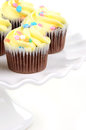 Festive easter chocolate cupcakes on white ruffled cake stand Royalty Free Stock Photography