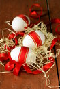 Festive eggs decorated with red ribbon symbol of easter holiday Royalty Free Stock Photography