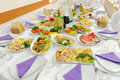 Festive food on table decorated wedding at restaurant Stock Photos