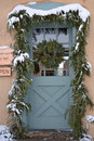 Festive front door christmas at christmastime decorated with a wreath snow and garland Royalty Free Stock Photography