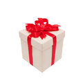 Festive gift. Beige box and red satin bow. Stock Photos