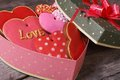 Festive gift box in heart shape with sweets on the table Royalty Free Stock Photo