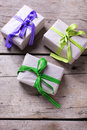 Festive gift boxes with presents on vintage wooden background.