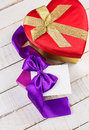 Festive gift boxes on wooden background with bow empty tag for your text selective focus Royalty Free Stock Photo