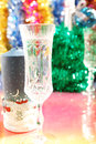 Festive glasses and a candle on the Christmas Stock Images
