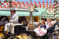 Festive goers during seville spring festival and ladies in andalusian costumes and horse carriage feria de abril de sevilla for Stock Photo