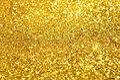 Festive gold glitter background bright Stock Photo