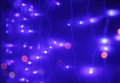 Festive lights abstract background with bokeh defocused dark blue background Royalty Free Stock Images