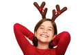 Festive little girl wearing antlers on white background Stock Photography
