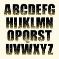 Festive luxury alphabet letters with glamour golden glitter confetti