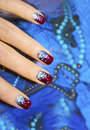 Festive nail design short nails blue background Royalty Free Stock Photo