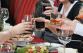 Festive party people at a banquet having fun and drinking wine and other drinks Royalty Free Stock Photo