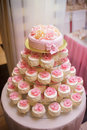 Festive pie with cakes multilevel support and a in a banquet room Stock Photography