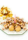 Festive profiteroles and golden ribbon Royalty Free Stock Photo
