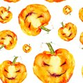 Festive pumpkin smiles on Halloween holiday. Watercolor illustration isolated on white background.Seamless pattern Royalty Free Stock Photo