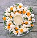 Festive raw food vegetable platter with hummus dip: cauliflower Royalty Free Stock Photo